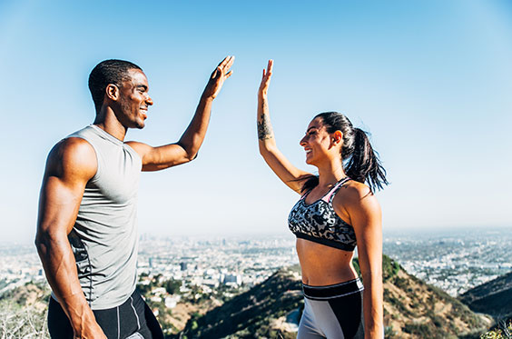 Fit couple with slim waists and toned arms that are possible with Z-Wave and CoolSculpting
