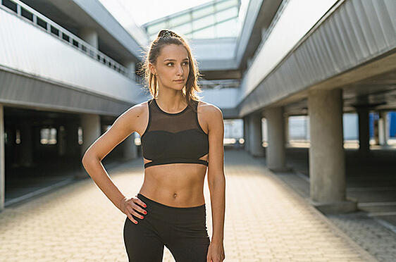 Fit woman with toned abs that are more defined after CoolSculpting
