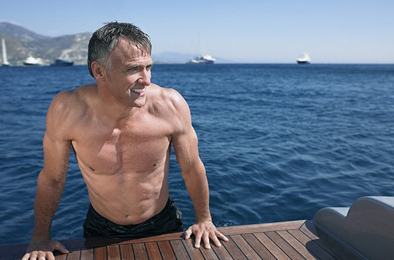 Mature man with muscular body that is possible with body sculpting treatments like CoolSculpting