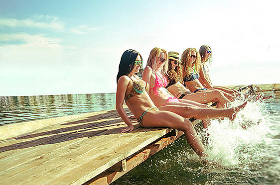 Thin women splashing with toned legs you can get with CoolSculpting